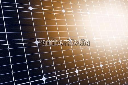 sunlight reflecting in solar panel