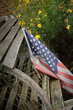 faded american flag on old wood