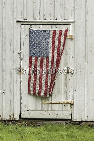 american flag hanging on barn door