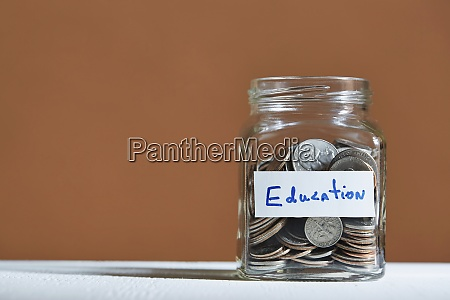 coins in jar collected for education