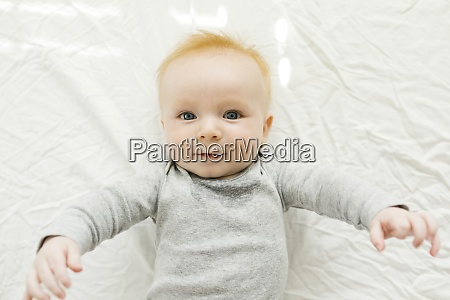 portrait of baby boy lying on