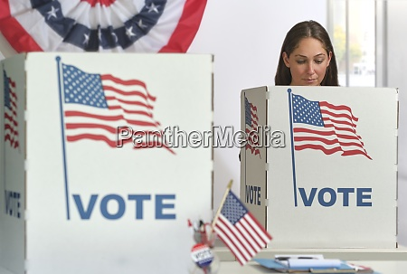 woman voting in polling place