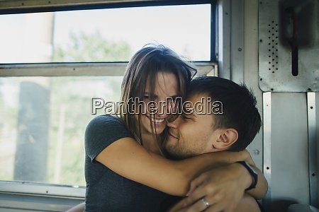 couple embracing on train