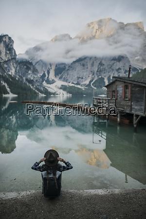 italy woman sitting by pragser wildsee