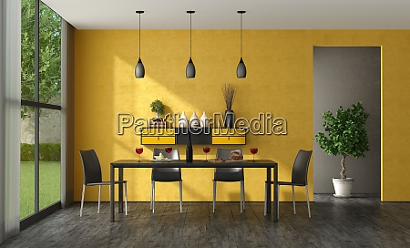 black and yellow minimalist dining room
