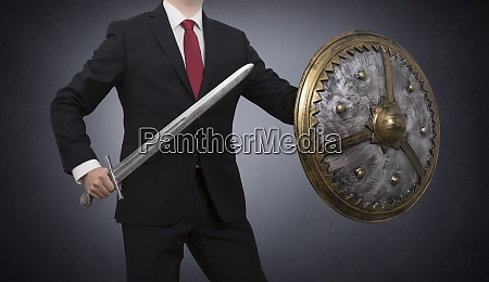 businessman with sword and shield on