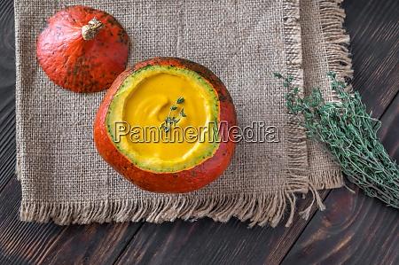 pumpkin soup served in hokkaido pumpkin