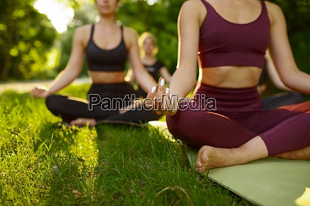 peaceful women relax group yoga training