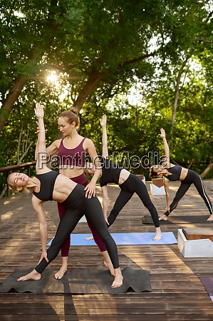 sportive women on yoga training with