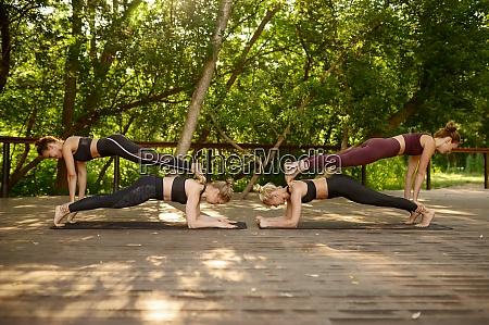 four women doing balance exercise group