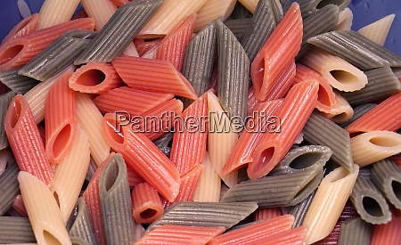 cooked colorful penne pile