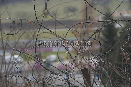 barbed wire fence at the border