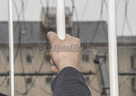 prisoner at the window of a