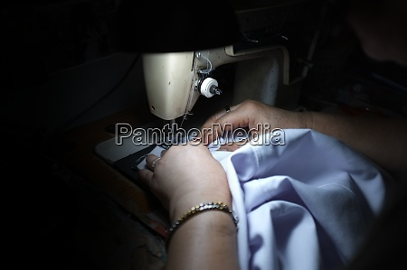 tailor woman working in his tailor