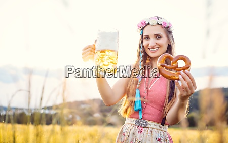 bavarian woman with beer and pretzel