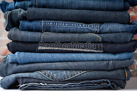 a pile of folded blue jeans