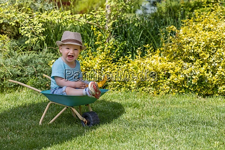 lovely baby boy is sitting on