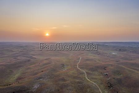 hazy sunrise over nebraska sandhills