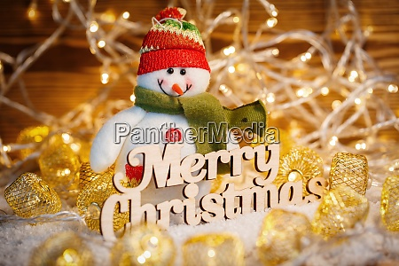 toy snowman at christmas garlands and