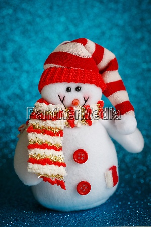 smiling snowman toy dressed in scarf