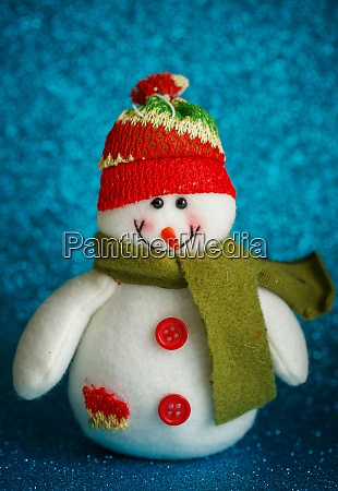 snowman toy on blue background new