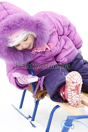 baby girl on sledges looks at