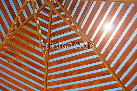 sunbeam makes its way through wooden