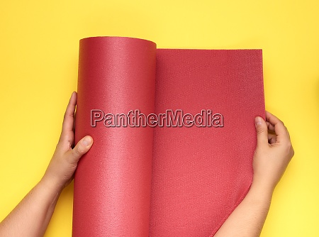 two female hands unfold a red