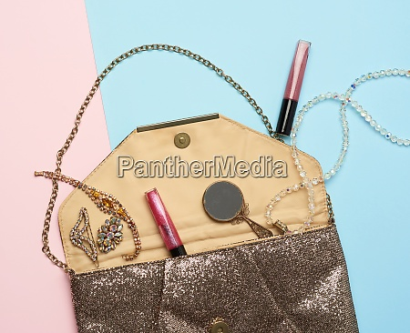 open gold clutch and dropped bracelets