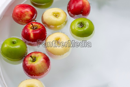 washing fresh apples in the water