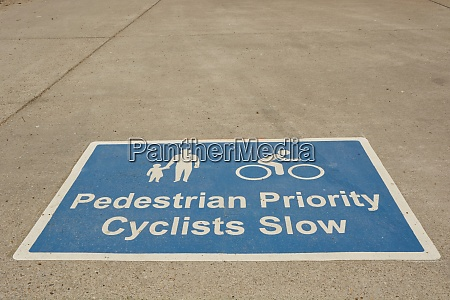 cyclist and pedestrian sign on walkway