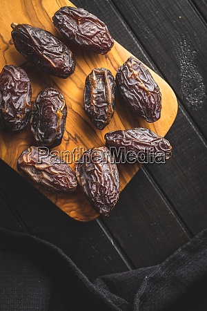 dried dates fruit on cutting board