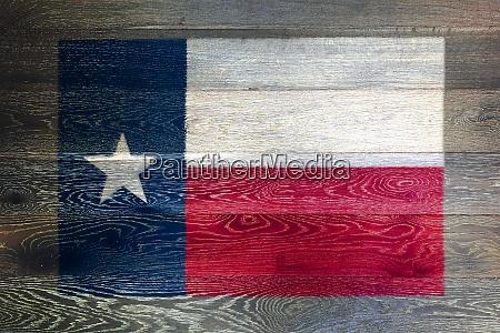 texas flag on rustic old wood
