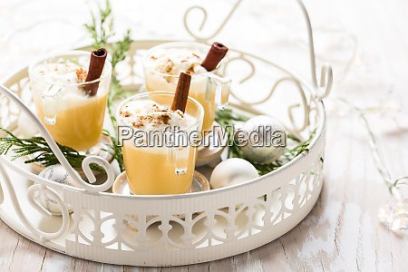 eggnog with cinnamon and nutmeg for