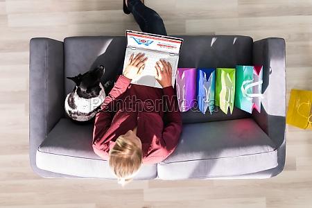 ecommerce online shopping on sofa