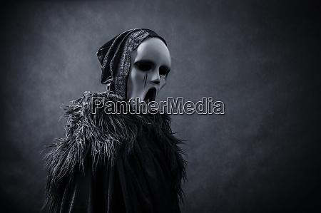 ghostly figure in hooded cloak in