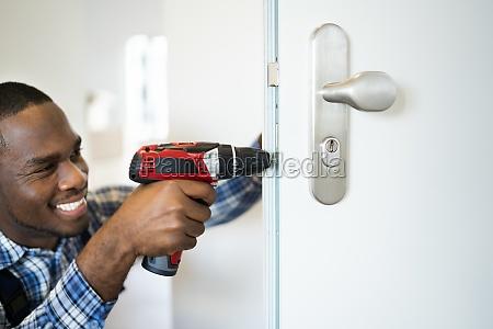 african locksmith man changing