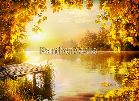 wooden pier by river