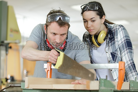 carpenter, and, apprentice, working, together, in - 28928220