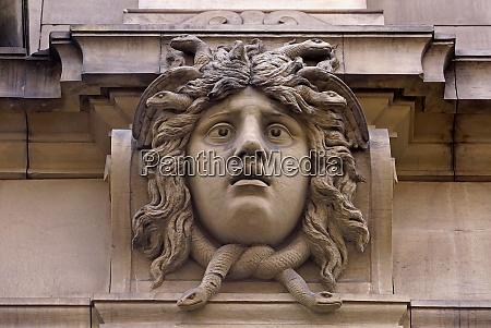 stone head on a house facade