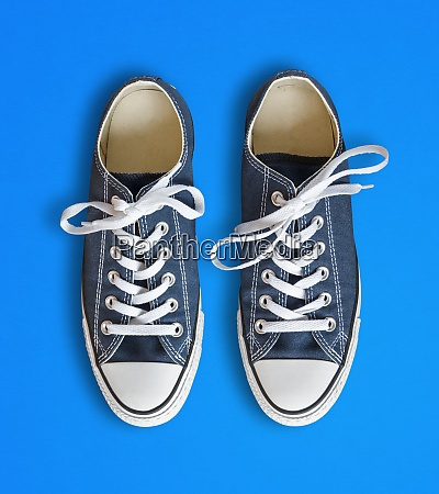 blue sneakers isolated on cyan background
