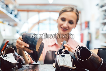 woman shoemaker taking shoes to be