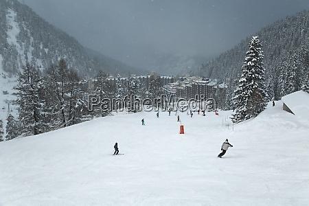 skiing slopes snowing
