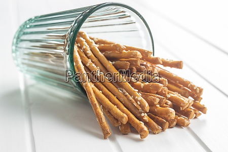salty sticks crunchy pretzels in glass