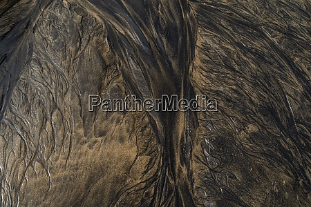 abstract natural patterns on wet sand