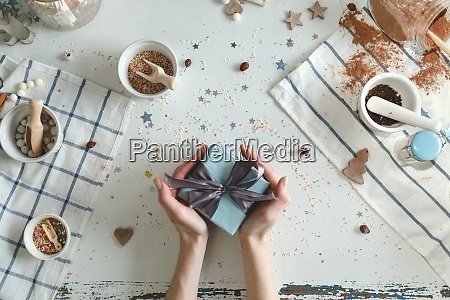 creative hobby womans hands wrap holiday