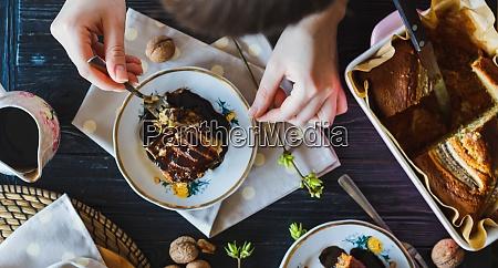 baker artist woman tasting a hot