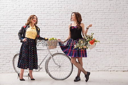 two young bright beautiful girlfriends with