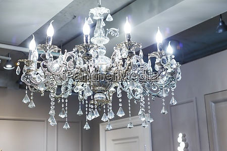 crystal chandelier shines hanging from the