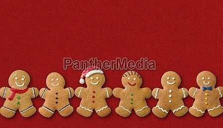 many gingerbread men on a red